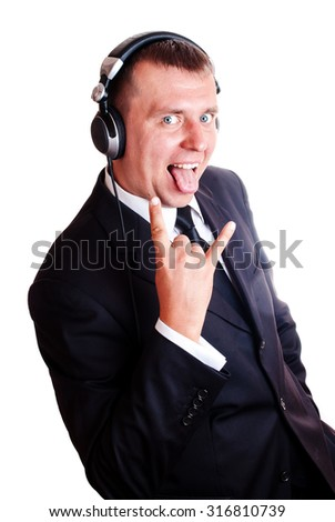 Emotional man in a business suit and wearing headphones on an isolated background