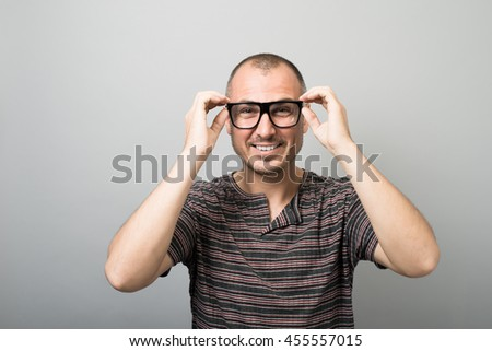 emotional man in glasses