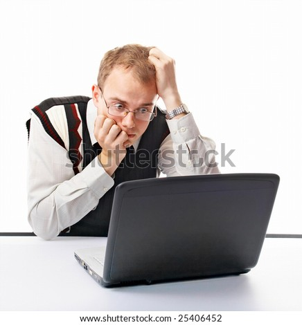 emotional man in office with computer on white background - stock photo