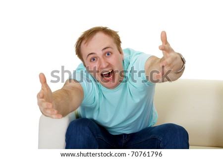 emotional man shouting, gesticulating, sitting on the couch. isolated on white background - stock photo
