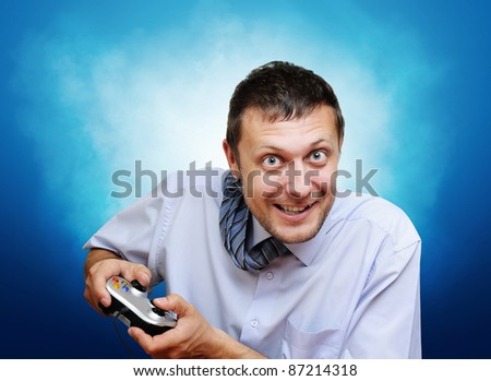 Emotional office clerk gamer with joystick on blue background - stock photo