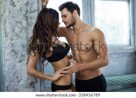Emotional photo of young couple in underwear - stock photo