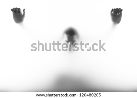 emotional picture of man and woman standing behind the milk glass/ Behind the window - stock photo