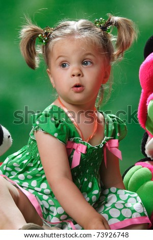 emotional portrait of a girl on a green background