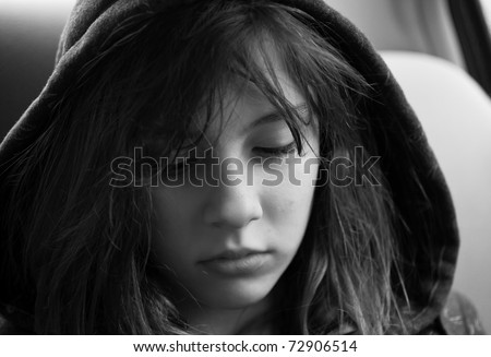 Emotional portrait of a teenage girl looking troubled - stock photo