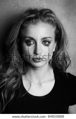 emotional portrait of a young  crying  girl (black and white shoot)