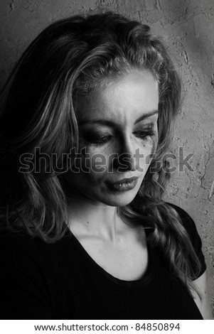 emotional portrait of a young  crying  girl (black and white shoot) - stock photo