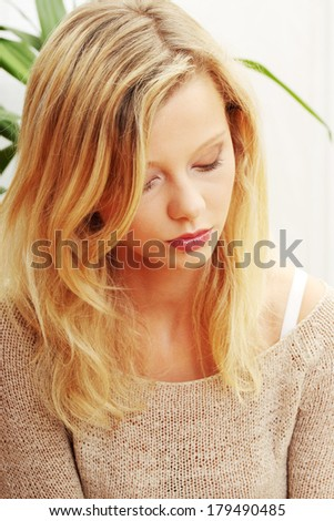 Emotional portrait of abused, beautiful, teen ,caucasian woman- violence concept, high emotional  - stock photo