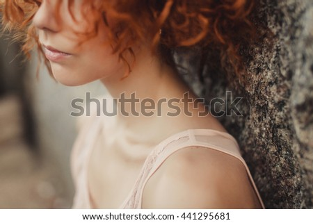 Emotional Portrait of Fashion stylish portrait of Pretty Young Hipster Ginger Woman,going crazy,Elegant black Hat,soft colors,cool Crazy girl.Red urban wall background.Surprised girl close up, Hot,sad - stock photo