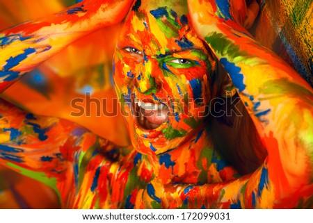 emotional portrait of girl in bodyart in studio - stock photo