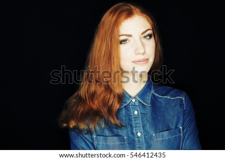 Emotional portrait of happy beautiful woman with red curly hair and natural makeup