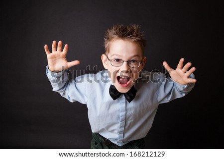 Emotional portrait of little boy over the black - stock photo