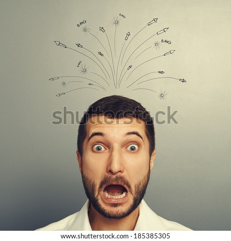 emotional portrait of stressed man over grey background - stock photo