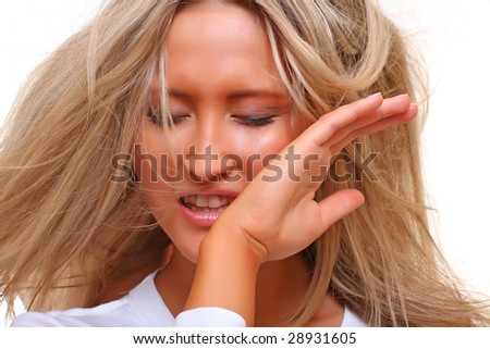 Emotional portrait of the beautiful woman with the light hair, dressed in the white, isolated on a white background