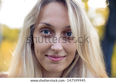 Emotional pretty blonde girl on the nature