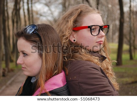 Emotional scene with two teenage girls - stock photo