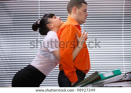 Emotional sexy scene -  passionate embraces of colleague - stock photo