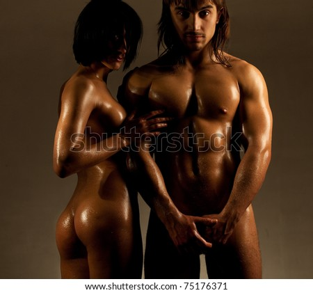 Emotional sexy scene - passionate embraces of temptation couple - stock photo