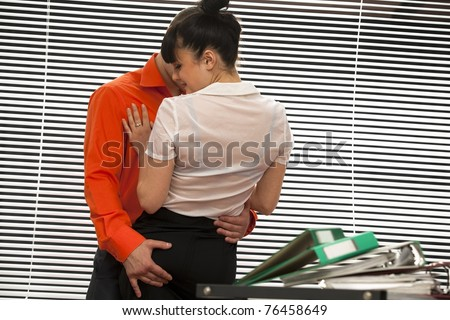 Emotional sexy scene -  secretary and her boss are catched in the act - stock photo