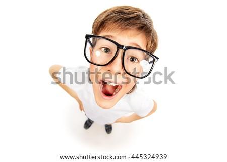 Emotional smart boy wearing big glasses. Education. Optics. Studio shot. Isolated over white. - stock photo