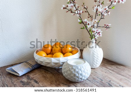 Emotional spring still life. Flowers and oranges.