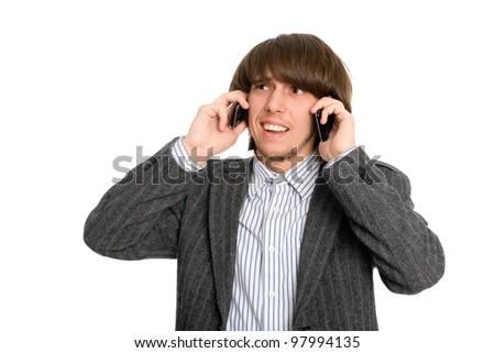 Emotional stockbroker talking on two mobile - stock photo