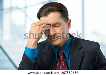 Emotional Stress. Businessman Exhausted in his office - stock photo
