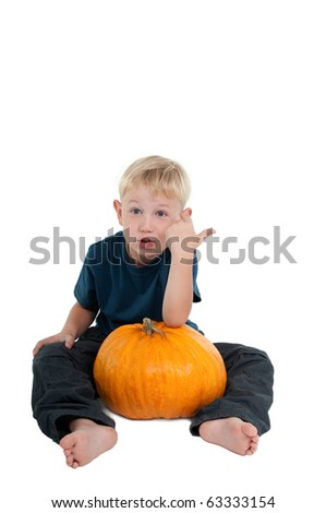 Emotional Surprising Seven Years Boy  boy Holding a Big Pumpkin in His Legs Sitting Isolated On White Background