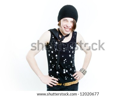 Emotional teenager in black hat smiling, isolated on white background