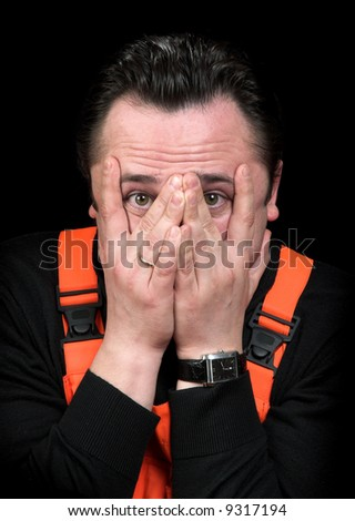 Emotional the man on a black background - stock photo