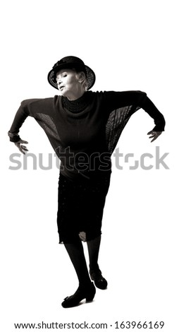 emotional woman posing with raised hands in studio, wearing clothes in retro style.Black and white photo - stock photo