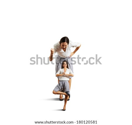 emotional woman screaming and showing fist to calm young woman. isolated on white background