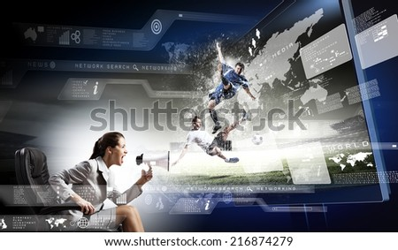 Emotional woman watching football match on 3 d tv - stock photo