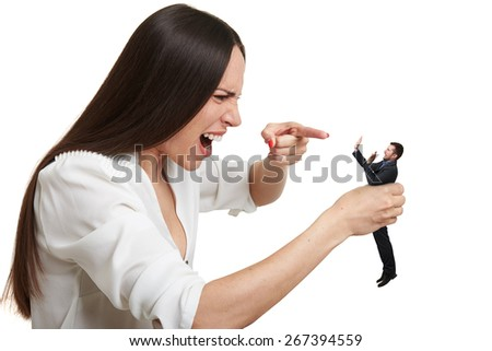 emotional yelling woman pointing at small scared man over white background - stock photo