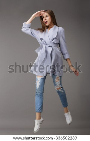 Emotional Young Woman in Outer Garments - stock photo