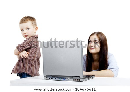 Emotions during using the laptop. A boy and a young woman in conflict. - stock photo