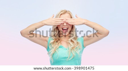emotions, expressions and people concept - smiling young woman or teenage girl covering her eyes with palms over rose quartz and serenity gradient background - stock photo