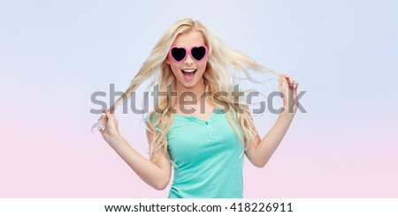 emotions, expressions, summer and people concept - smiling young woman or teenage girl in sunglasses holding her strand of hair over rose quartz and serenity gradient background - stock photo