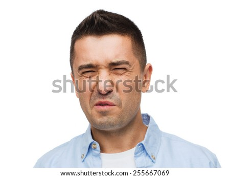 emotions, facial expression and people concept - man wrying of unpleasant smell - stock photo