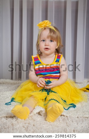 emotions of the nice girl in a yellow dress  - stock photo