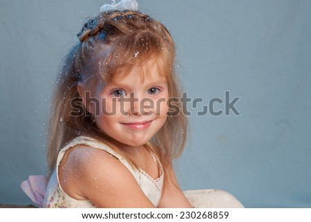 emotions of the nice girl on a blue background  - stock photo