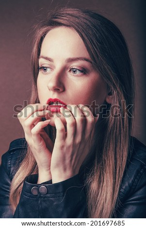 Emotive portrait of a young beautiful girl - stock photo