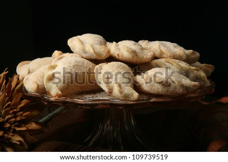 empanadas / This empanada is sweet, filled with marmalade and topped with sugar and cinnamon. - stock photo
