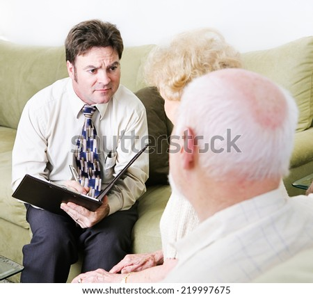 Empathetic couples counselor helping a senior couple with their marriage.   - stock photo