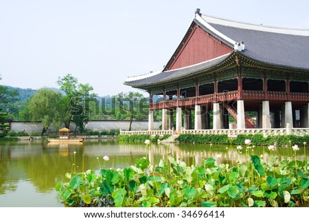 Emperor palace in Seoul. South Korea. Lake and boat - stock photo