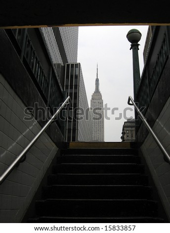 Empire State Building in New York, photo taken from metro station - stock photo