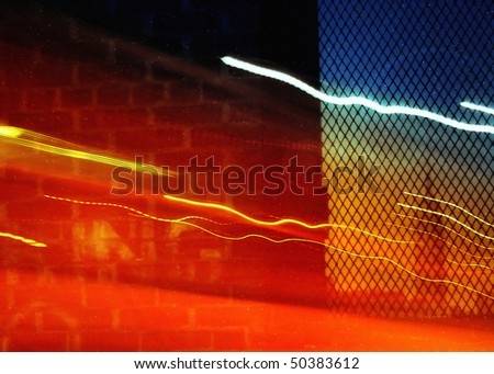 Empire State Building seen through a window with light trails - stock photo