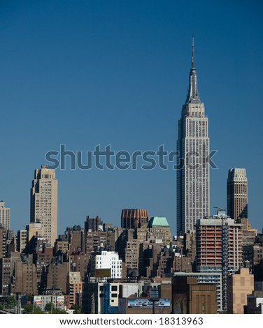 Empire State Building towering over the New York City Skyline - stock photo