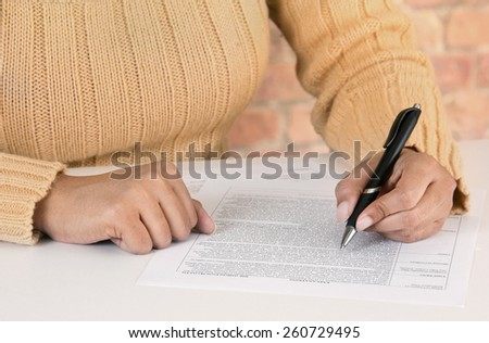 Employed woman at work place - stock photo