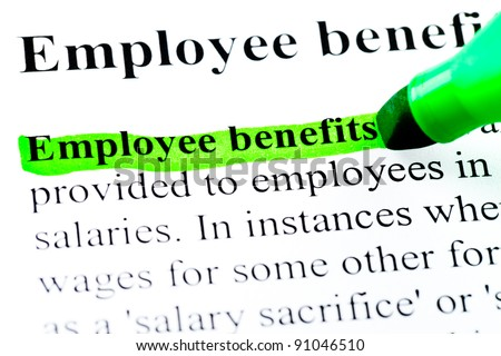 Employee benefits definition highlighted by green marker on white paper background - stock photo